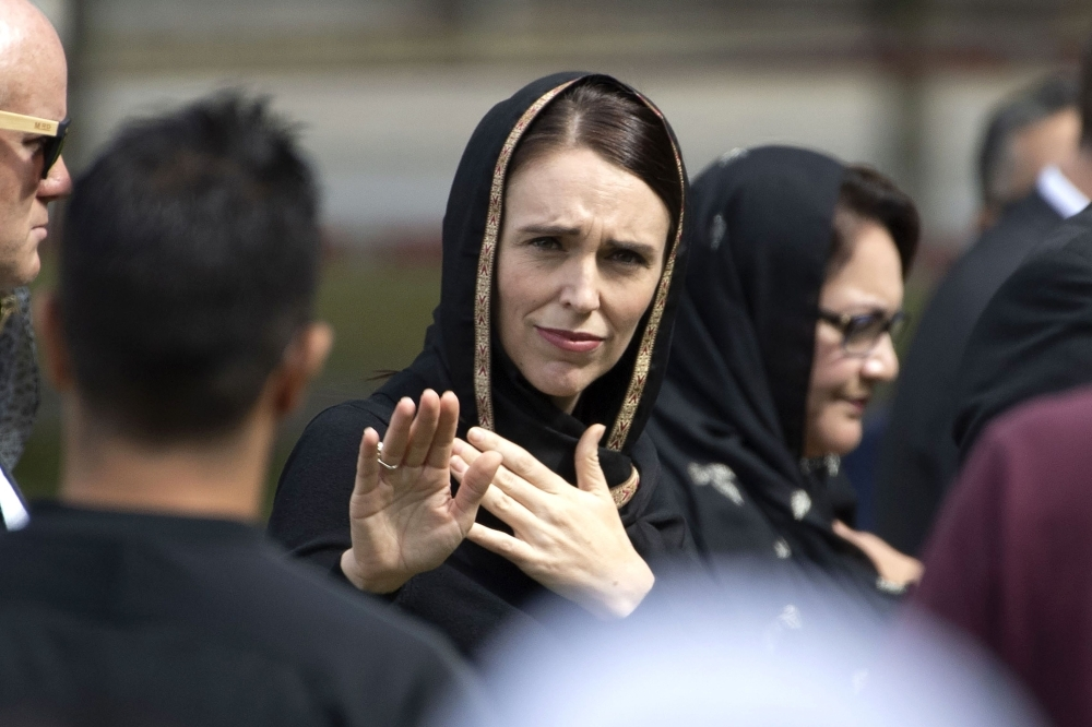 New Zealand's Prime Minister Jacinda Ardern gestures as she departs following a gathering for congregational Friday prayers and two minutes of silence for victims of the twin mosque massacre, at Hagley Park in Christchurch, on Friday. — AFP