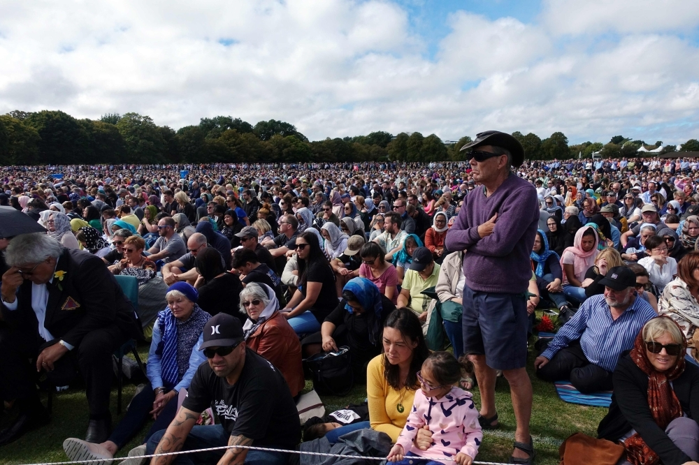 People gather for prayers and to observe a two minutes of silence for victims of the twin mosques massacres at Hagley Park in Christchurch on Friday. — AFP