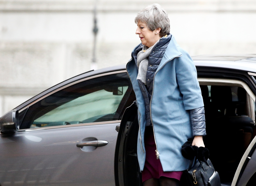 Britain's Prime MinisterTheresaMayis seen outside Downing Street in London, Britain, on Friday. — Reuters