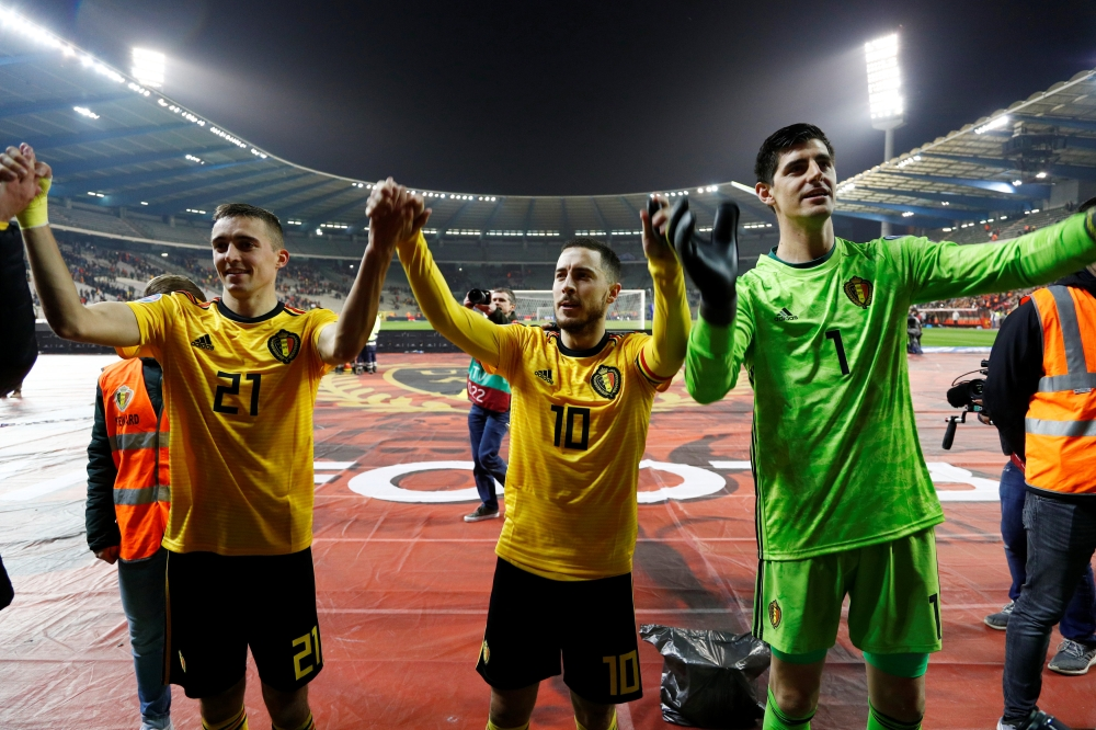 Belgium's Timothy Castagne, Eden Hazard and Thibaut Courtois celebrate after the Euro 2020 qualifier , Group I match  against Russia at the King Baudouin Stadium, Brussels, Belgium, on Thursday.    — Reuters