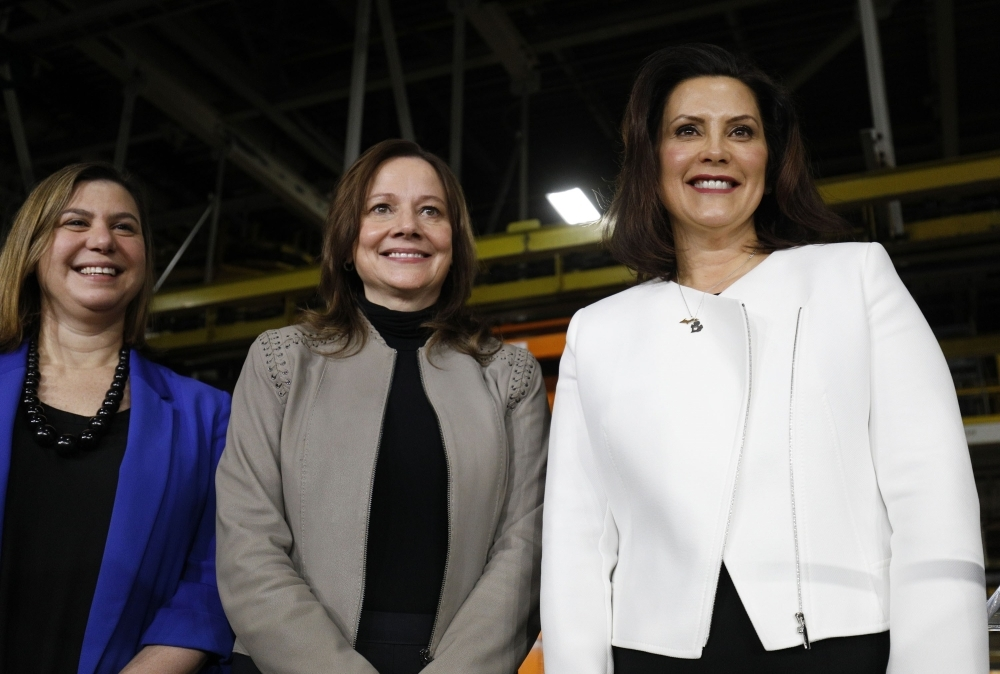 General Motors Chairman and CEO Mary Barra (C) stands on stage with Michigan Gov. Gretchen Whitmer (R) and Rep. Elissa Slotkin (D-MI) after she announced a $300 million investment in the GM Orion Assembly Plant plant for electric and self-driving vehicles at the Orion Assembly Plant on Friday in Lake Orion, Michigan.   — AFP