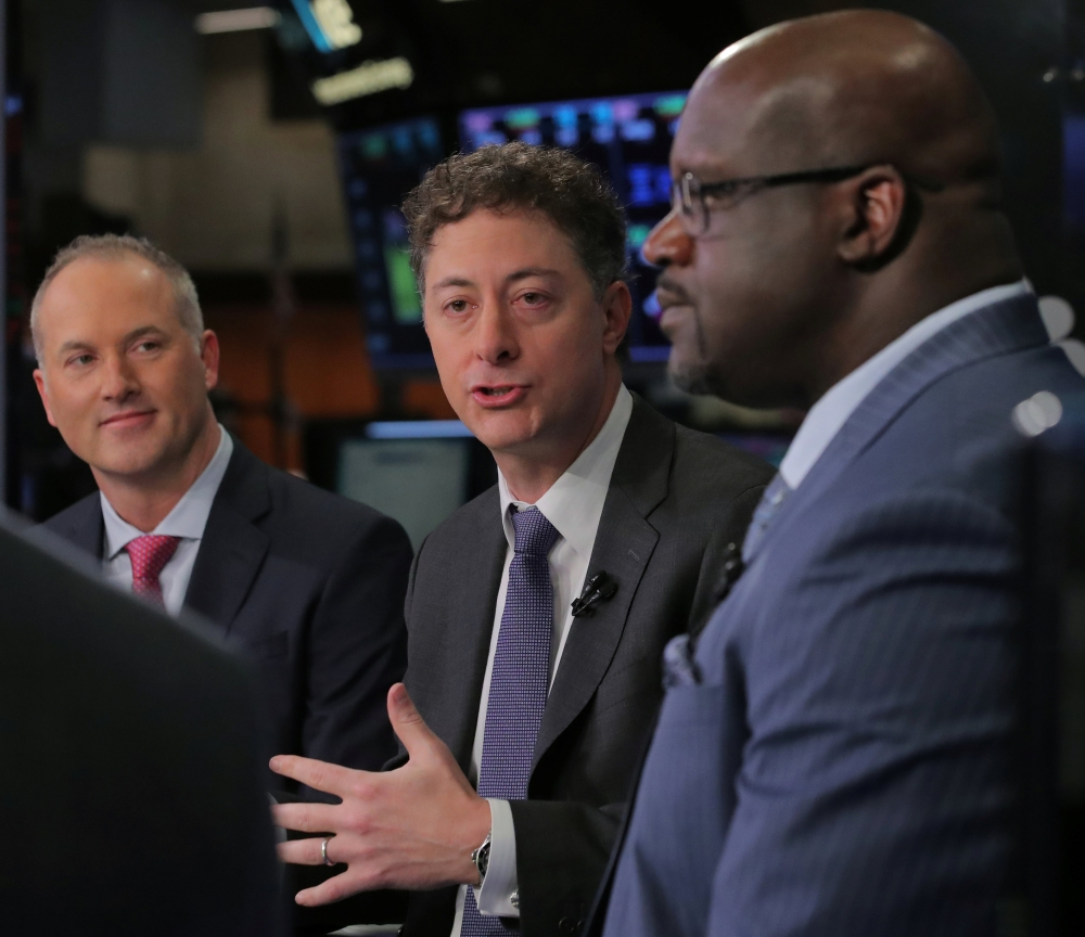 Jeffrey Smith, CEO of Starboard Value LP and chairman of Papa John's International Inc., speaks with Steve Ritchie, CEO of Papa John's, and former basketball star, Shaquille O'Neal, during an interview on CNBC on the floor of the New York Stock Exchange (NYSE) in New York, US, Friday. — Reuters