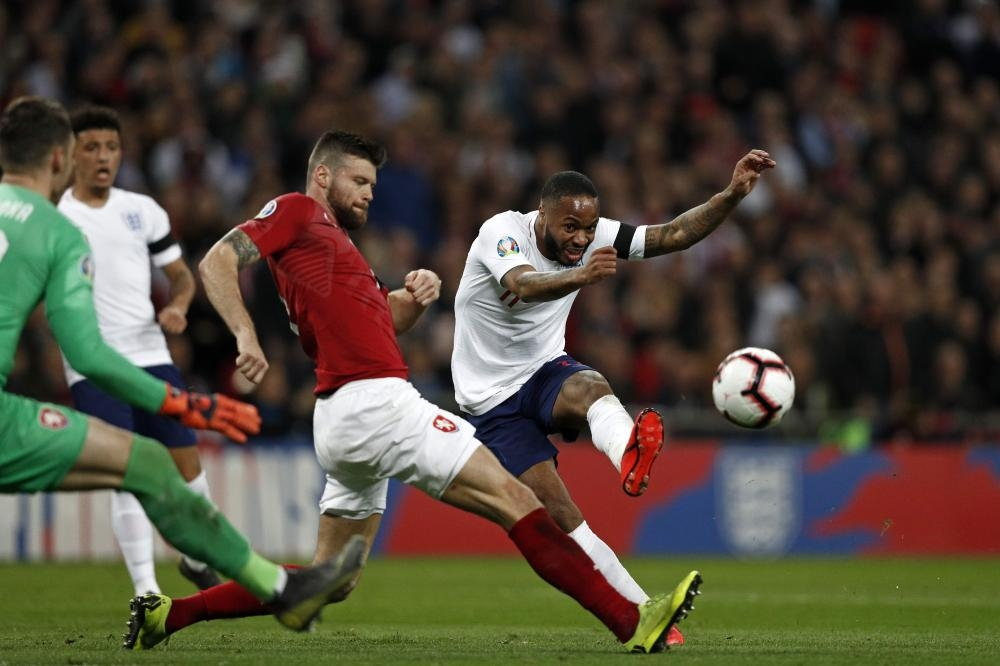 England's Raheem Sterling (R) shoots to score during the UEFA Euro 2020 Group A qualification match against Czech Replublic at Wembley Stadium in London Friday. — AFP