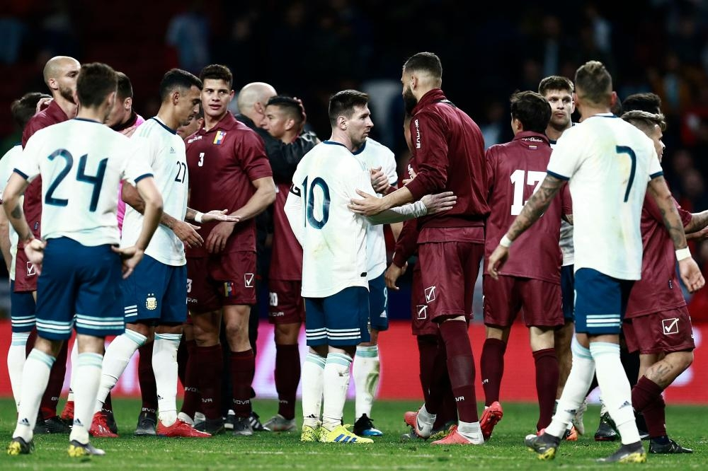 Argentina's Lionel Messi (C) and teammates congratulate Venezuela's players at the end of an international friendly match at the Wanda Metropolitano Stadium in Madrid Friday in preparation for the Copa America to be held in Brazil in June and July 2019. — AFP