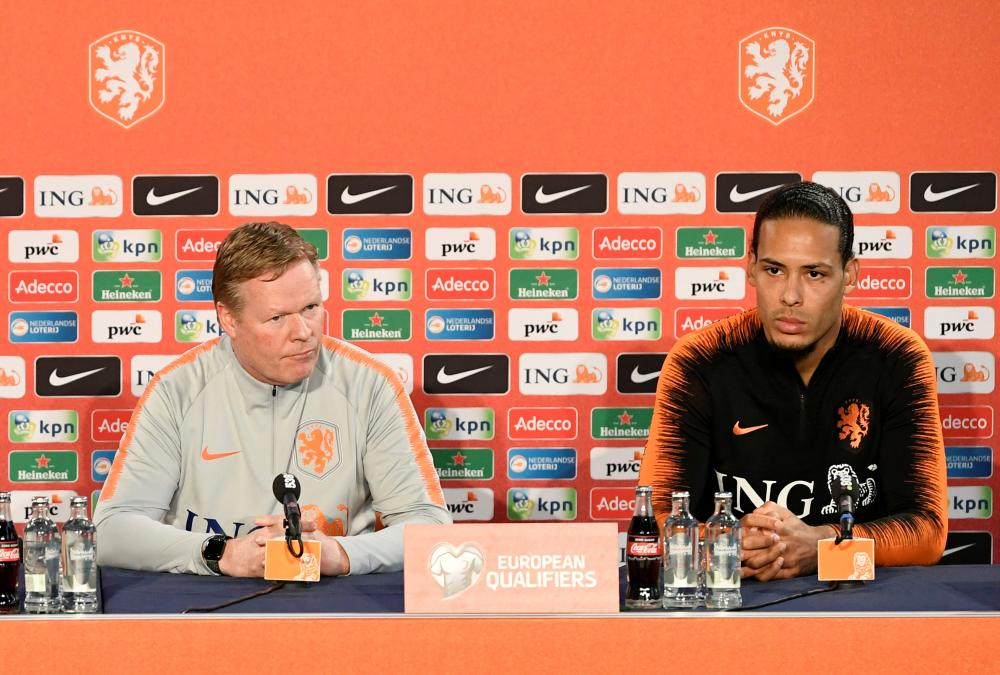 Netherlands coach Ronald Koeman and captain Virgil van Dijk during a press conference at KNVB Campus, Zeist, Netherlands, Saturday. — Reuters