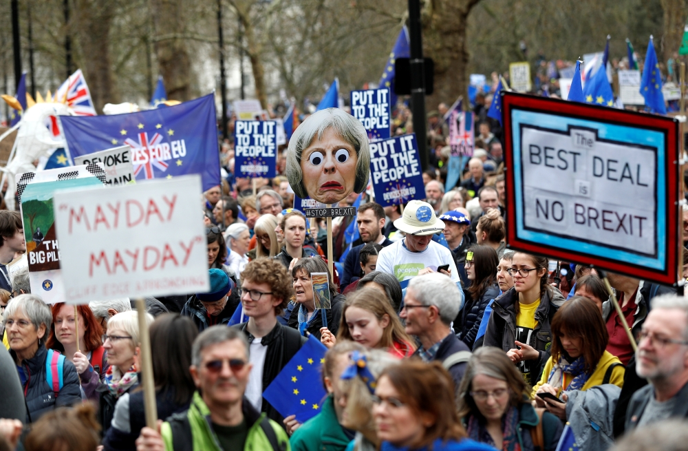 EU supporters, calling on the government to give Britons a vote on the final Brexit deal, participate in the 'People's Vote' march in central London, Saturday. — Reuters