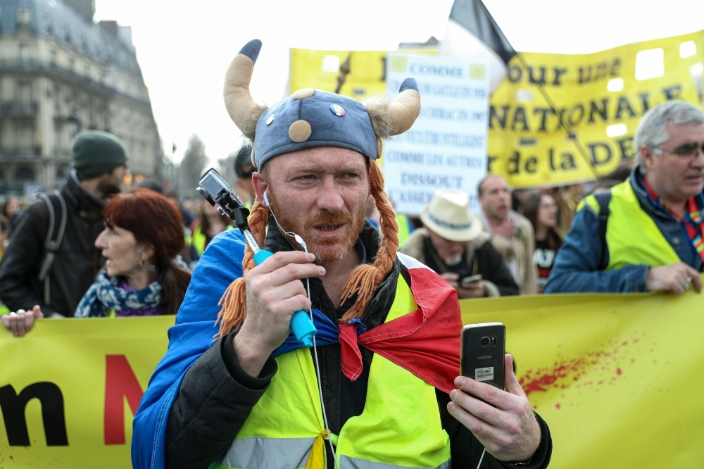 A 'Yellow Vest' protester dressed as a Gaul takes part in an anti-government demonstration in Paris, Saturday. — AFP