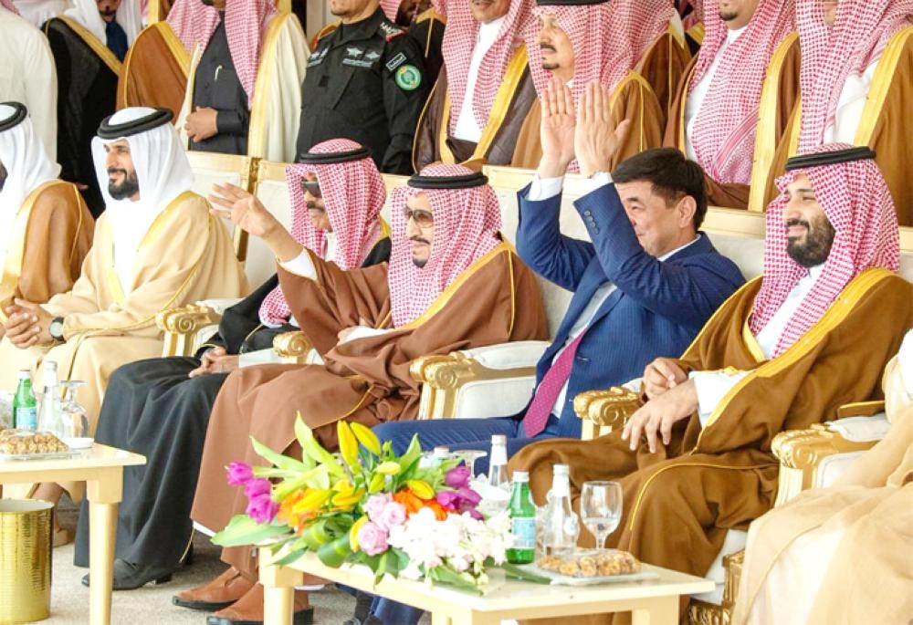 Custodian of the Two Holy Mosques King Salman along with Crown Prince Muhammad Bin Salman and dignitaries at the 3rd King Abdulaziz Camel Festival in Southern Sayahad on Saturday. – SPA