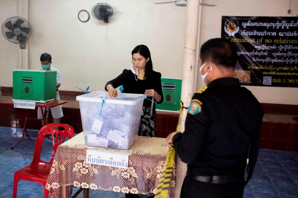 Voters cast their ballots at a polling station in Chiang Mai on Sunday during Thailand's general election. — AFP