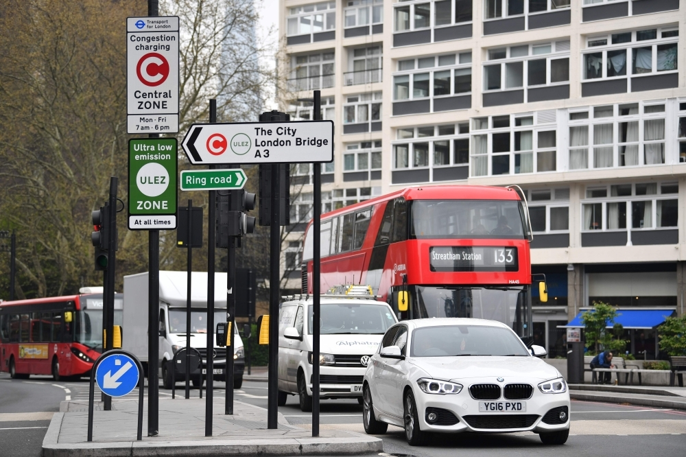 New signs for the ultra-low emission zone (Ulez) are pictured in central London on Monday. — AFP