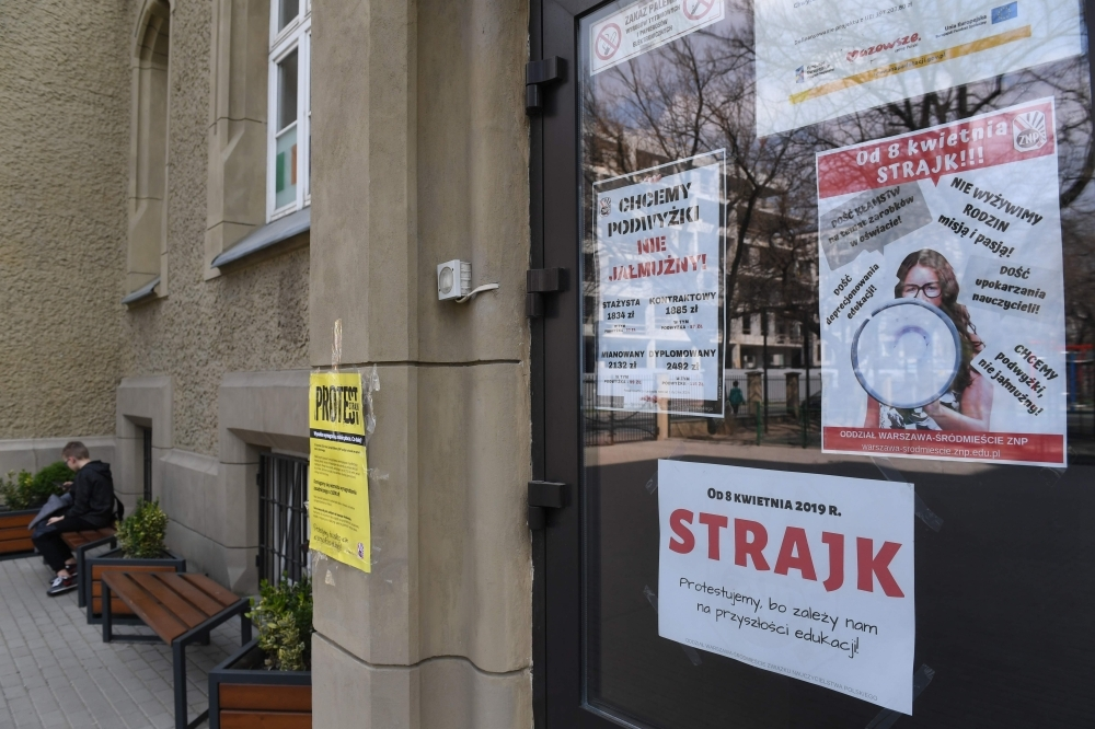 Posters declaring the participation at the indefinite nationwide teachers' strike at a school in Warsaw on Monday. — AFP