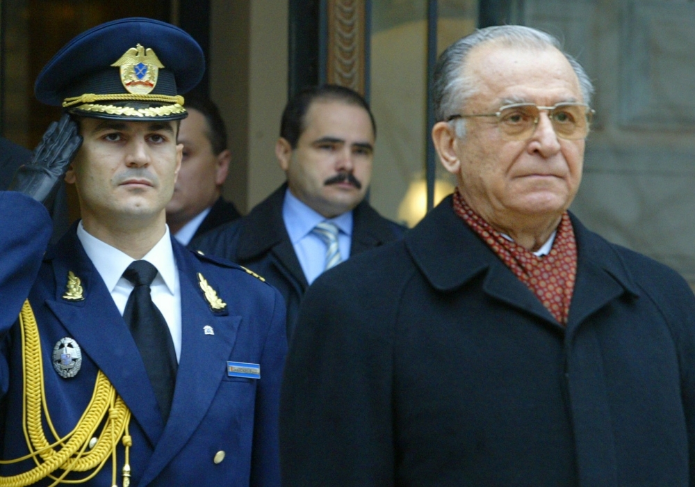 Former President of Romania, Ion Iliescu, right, attends an official ceremony as Iliescu leaves the Cotroceni Palace, the Romanian presidency headquarters in Bucharest, Romania, in this Dec. 21, 2004 file photo. — AFP
