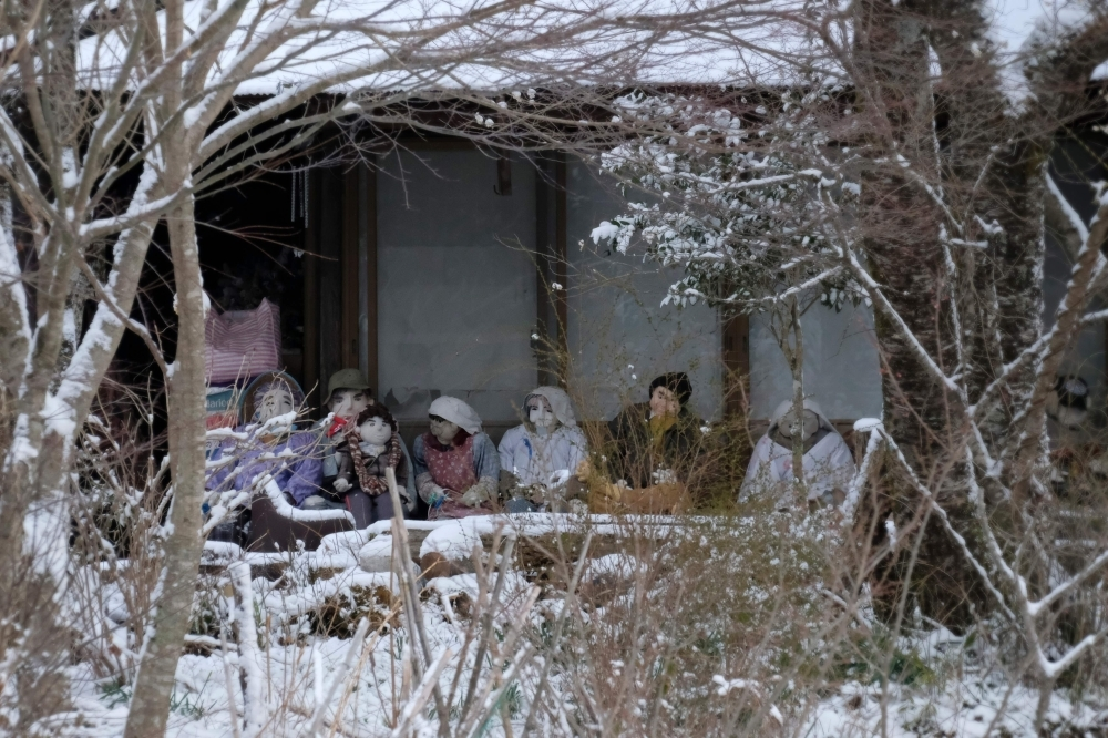 Life-size dolls are displayed at a house veranda in the tiny village of Nagoro in western Japan, in this March 16, 2019 file photo. — AFP