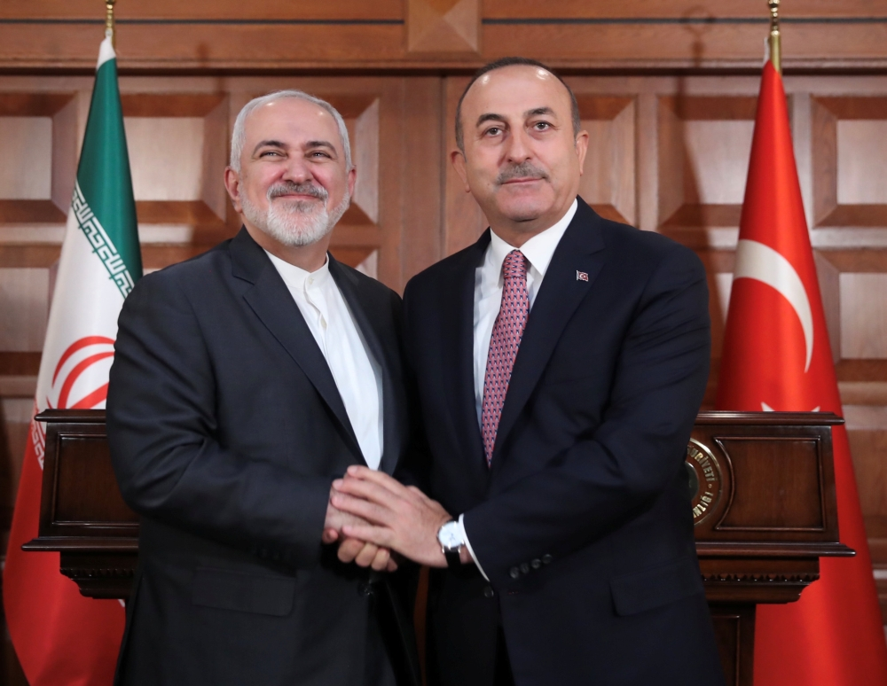 Turkish Foreign Minister Mevlut Cavusoglu meets with his Iranian counterpart Mohammad Javad Zarif in Ankara on Wednesday. — Reuters