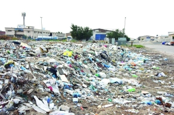 Garbage is dumped on an empty plot in the industrial area on Tarout Island in Qatif governorate.