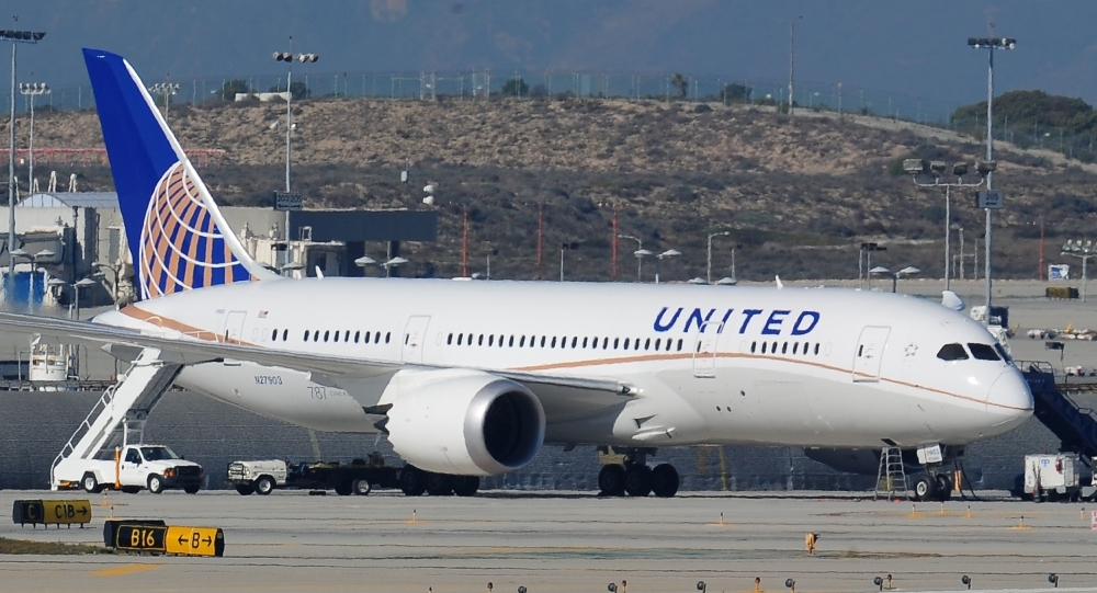 In this file photo a grounded United Boeing 787 Dreamliner is seen on the tarmac at Los Angeles International Airport. United Continental still expects to receive new Boeing 737 MAX planes in 2019 and does not expect a fight with the manufacturer over recovering costs from the planes' grounding, United executives said on Wednesday. — AFP