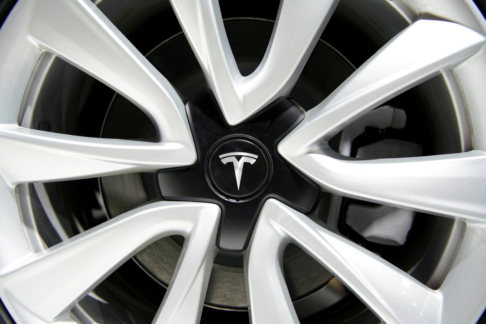 A Tesla logo is seen on a wheel rim during the media day for the Shanghai auto show in Shanghai, China, in this recent photo. — Reuters