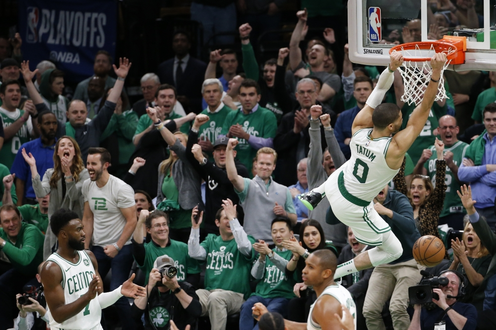 Boston Celtics forward Jayson Tatum (0) reacts after dunking the ball during the second half in game two of the first round of the 2019 NBA Playoffs against the Indiana Pacers at TD Garden. — Reuters