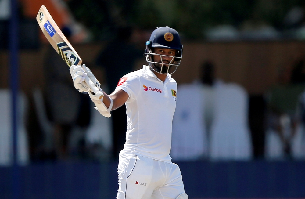 File photo shows Sri Lanka's Dimuth Karunaratne celebrating his half century during the Third Test against England in Colombo, Sri Lanka. — Reuters