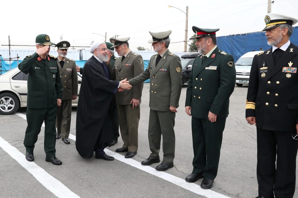 Iranian President Hassan Rohani arrives to attend the National Army Day ceremony parade in Tehran, Thursday. — Reuters