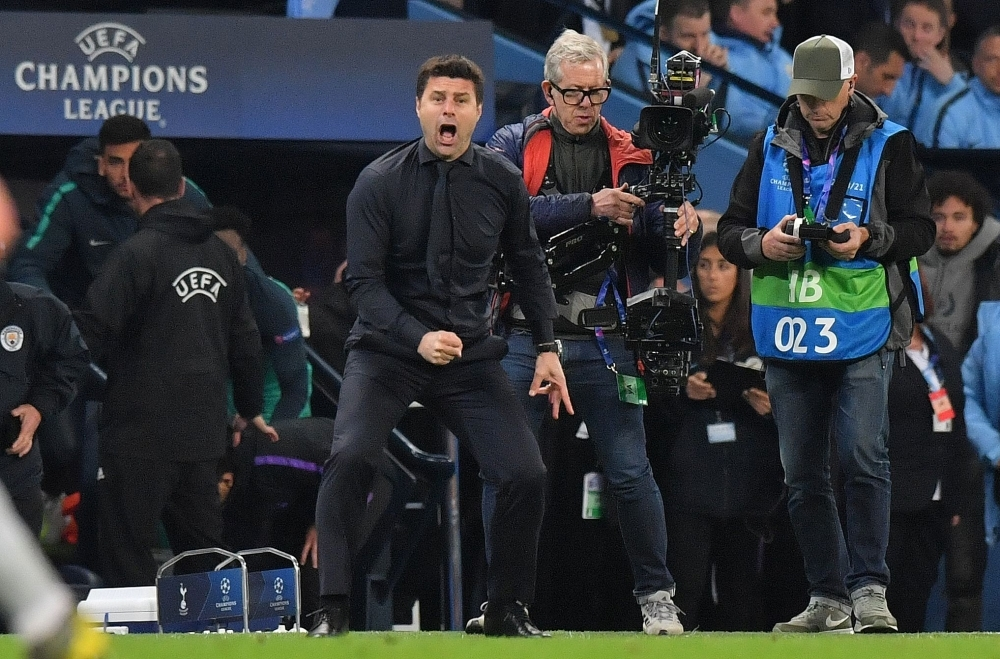 Tottenham Hotspur's Argentinian head coach Mauricio Pochettino celebrates at the final whistle during the UEFA Champions League quarterfinal second leg football match between Manchester City and Tottenham Hotspur at the Etihad Stadium in Manchester, north west England. The match ended 4-4, but Tottenham progress to the semifinals on goal difference. — AFP