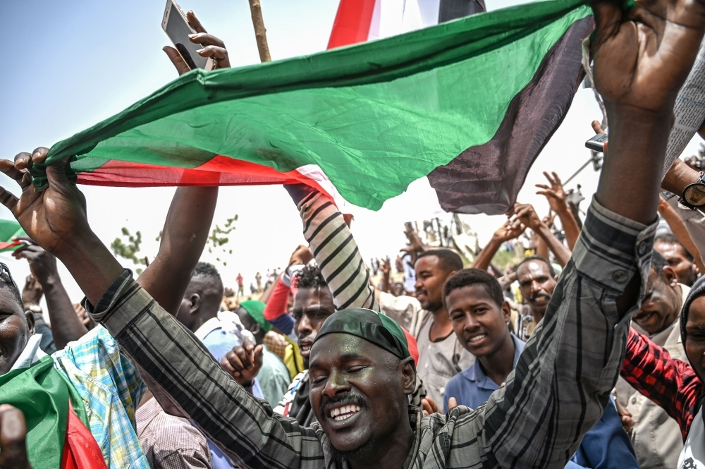 Sudanese protesters shout slogans during a protest outside the army complex in the capital Khartoum on Thursday. — AFP