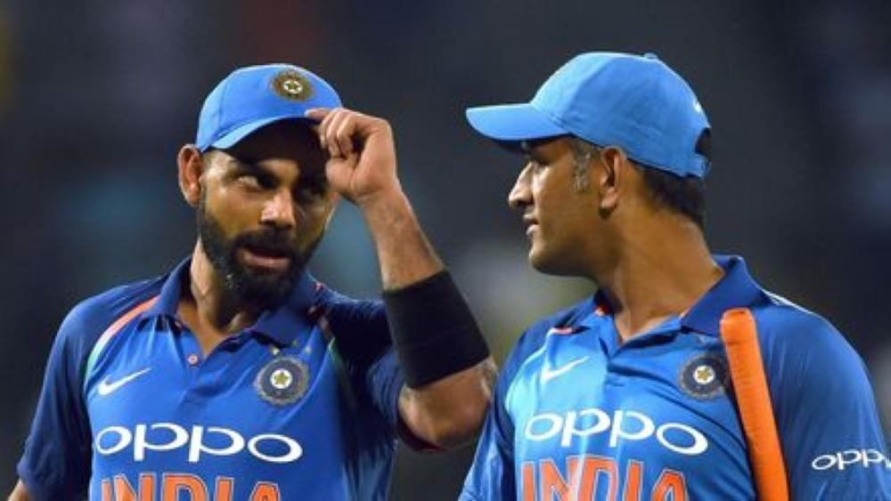 India's Virat Kohli, left, has gone to bat for his former captain Mahendra Singh Dhoni, right, saying it was unfortunate to see so many people going after the veteran player. — AFP