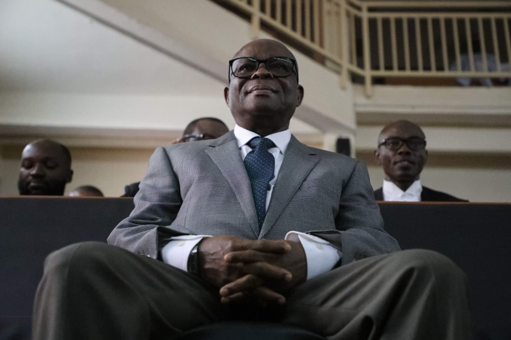 Suspended Chief Justice of Nigeria (CJN) Walter Samuel Nkanu Onnoghen, right, appears at the Code of Conduct Tribunal during his final judgement on corruption allegations in Abuja on Thursday. — AFP