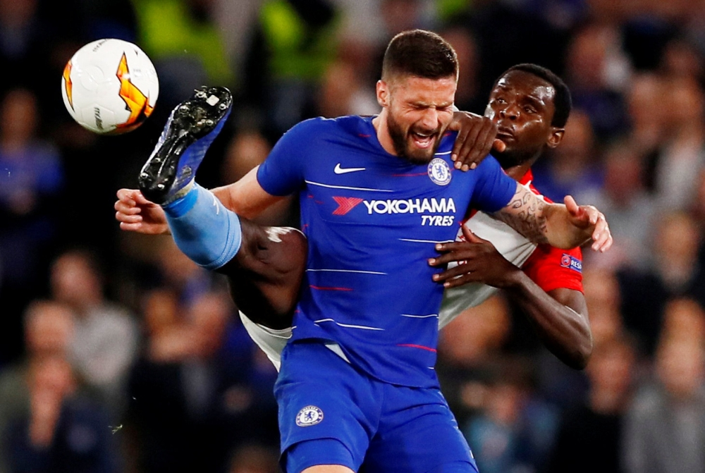 Chelsea's Olivier Giroud in action with Slavia Prague's Michael Ngadeu-Ngadjui during the Europa League quarterfinal second leg clash at Stamford Bridge, London, Britain, on Thursday. — Reuters