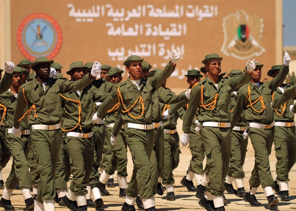 Fighters from the self-proclaimed Libyan National Army loyal to Khalifa Haftar attend their graduation ceremony at a military academy in Libya's eastern city of Benghazi on Thursday. — AFP