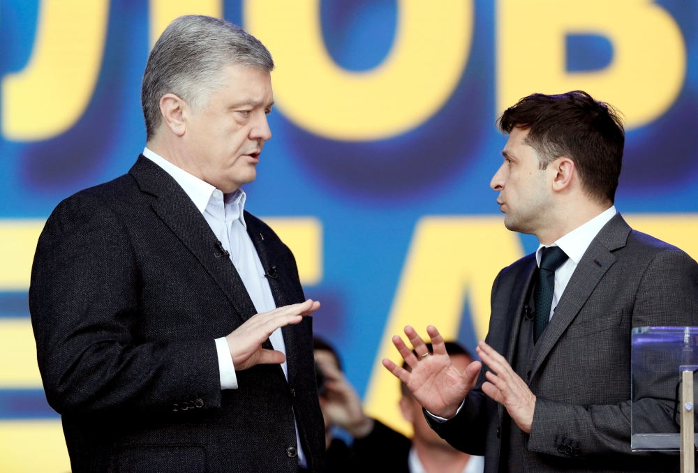 Ukraine's President and presidential candidate Petro Poroshenko attends a policy debate with his rival, comedian Volodymyr Zelenskiy, at the National Sports Complex Olimpiyskiy stadium in Kiev, Ukraine, on Friday. — Reuters
