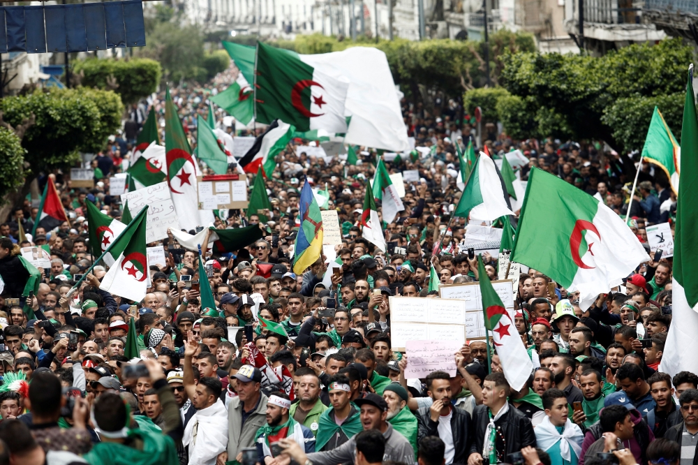 Demonstrators hold flags and banners as they return to the streets to press demands for wholesale democratic change well beyond former President Abdelaziz Bouteflika's resignation, in Algiers, Algeria, on Friday. — Reuters