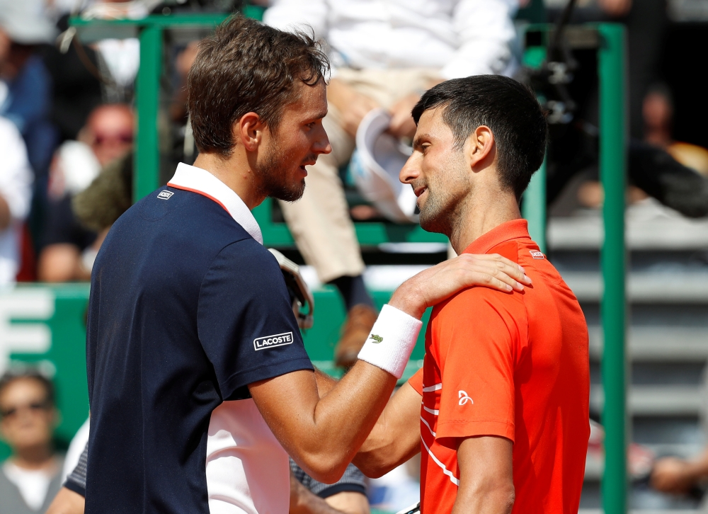 Russia's Daniil Medvedev with Serbia's Novak Djokovic after winning their quarterfinal match of the ATP 1000 - Monte Carlo Masters at the Monte-Carlo Country Club, Roquebrune-Cap-Martin, France, on Friday. — Reuters