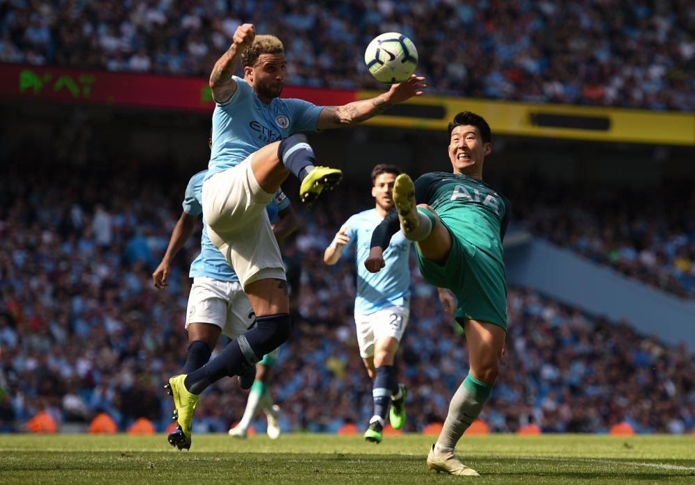 Tottenham Hotspur's striker Son Heung-min (R) tangles with Manchester City's defender Kyle Walker (L) during their English Premier League match at the Etihad Stadium in Manchester Saturday. — AFP