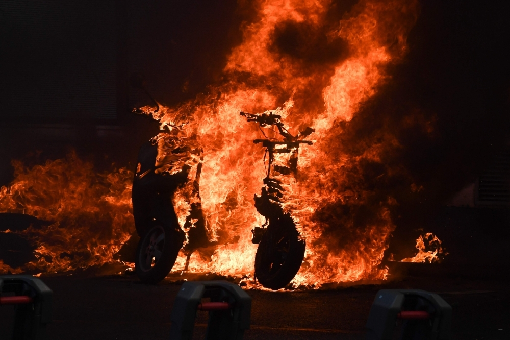 "A picture shows a scooter set ablaze during an anti-government demonstration called by the ""Yellow Vests"" movement in Paris on Saturday.  — AFP"