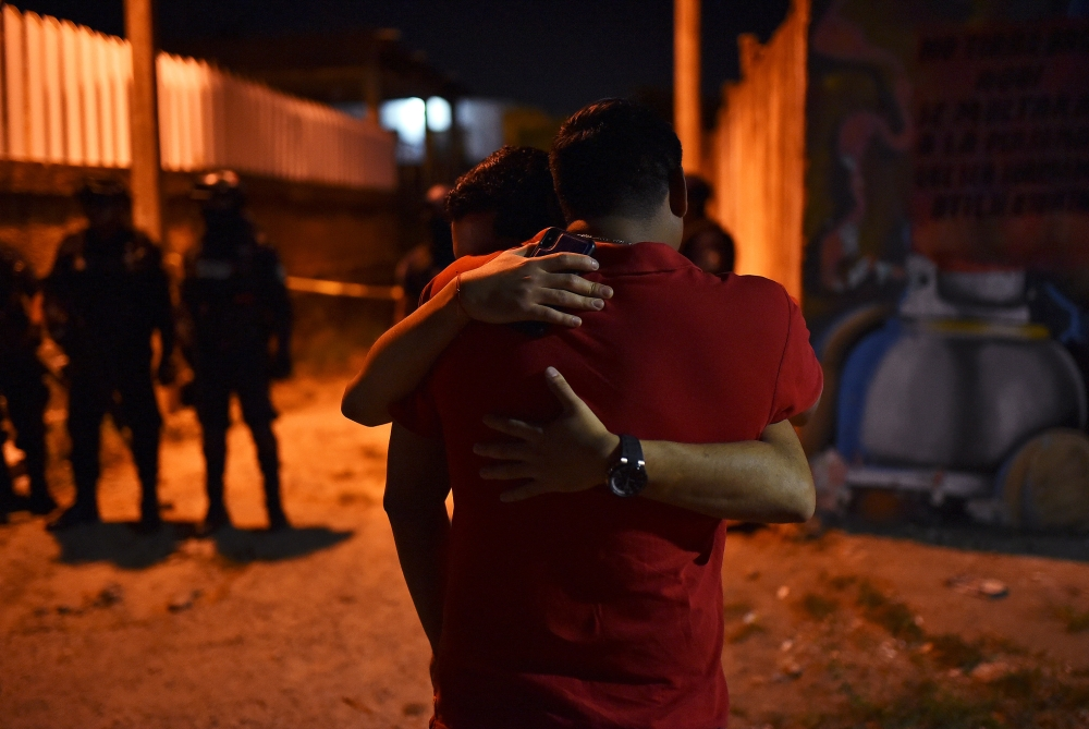 People react at a crime scene where unidentified assailants opened fire at a bar in Minatitlan, in Veracruz state, Mexico, on Friday. — Reuters
