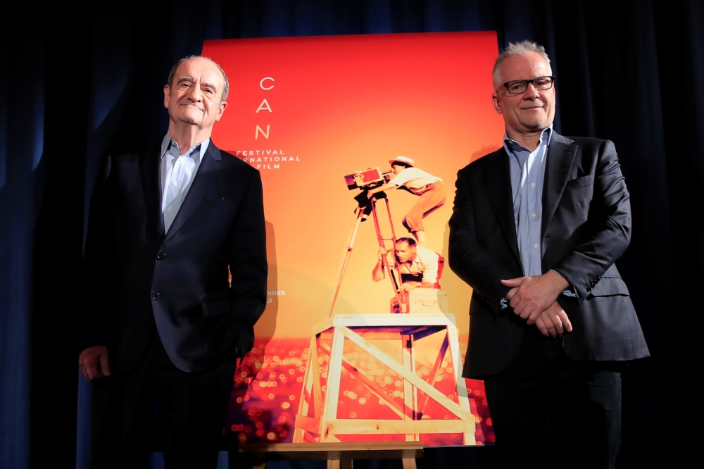 Cannes Film festival general delegate Thierry Fremaux and Cannes Film festival president Pierre Lescure pose next to the poster of the 72nd Cannes International Film Festival during a news conference to announce its official selection in Paris. — Reuters