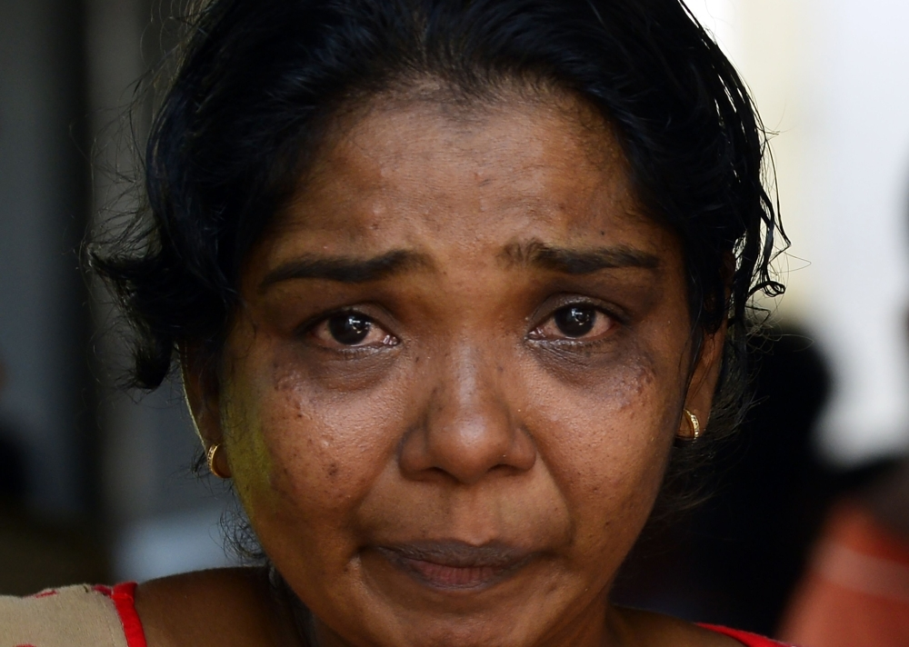 A Sri Lankan relative of a bomb blast victim weeps at a morgue in Colombo on Monday, as people gather hoping to identify loved ones missing or killed in the Easter Sunday bomb attacks on churches and hotels. — AFP