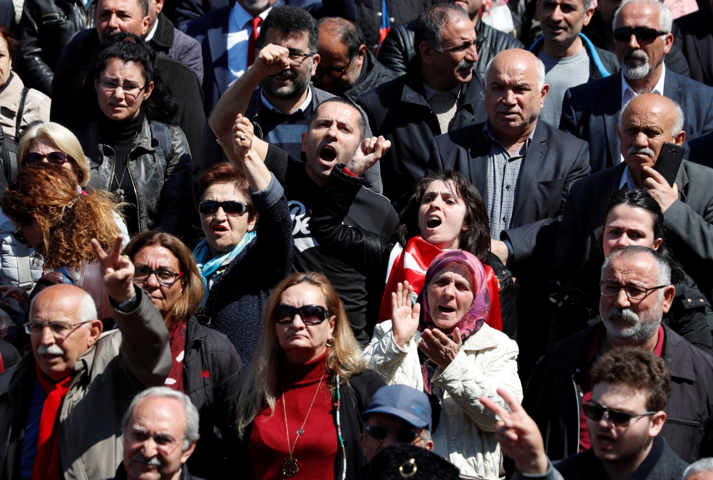 Supporters of the main opposition Republican People's Party (CHP) shout anti-government slogans during a protest against the attack on their leader Kemal Kilicdaroglu, in Istanbul, Monday. — Reuters