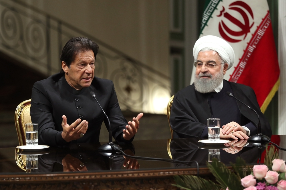 Iranian President Hassan Rohani (right) and Pakistani Prime Minister Imran Khan giving a press conference in the capital Tehran. — AFP