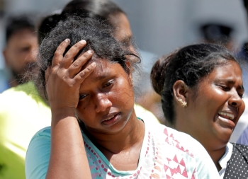 Relatives of victims react at a police mortuary in Colombo on Monday, a day after bomb blasts ripped through churches and luxury hotels on Easter. — Reuters