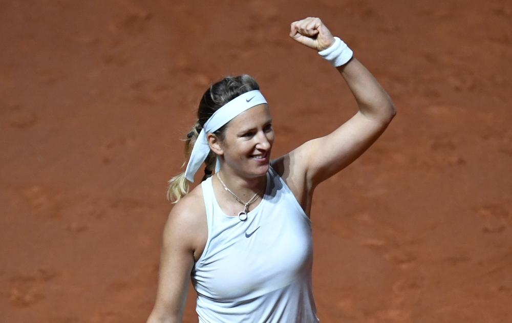 Belarus' Victoria Azarenka celebrates after winning her match against Russia's Vera Zvonareva at the WTA Tennis Grand Prix in Stuttgart Wednesday. — AFP