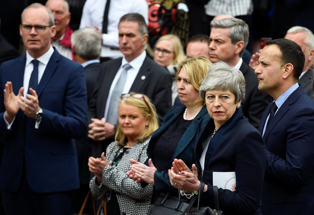 Britain's Prime Minister Theresa May, Ireland's Prime Minister (Taoiseach) Leo Varadkar, Britain's Secretary of State for Northern Ireland Karen Bradley and Simon Coveney, Ireland's Tanaiste and Minister for Foreign Affairs attend the funeral of journalist Lyra McKee at St. Anne's Cathedral in Belfast, Northern Ireland, on Wednesday. — Reuters