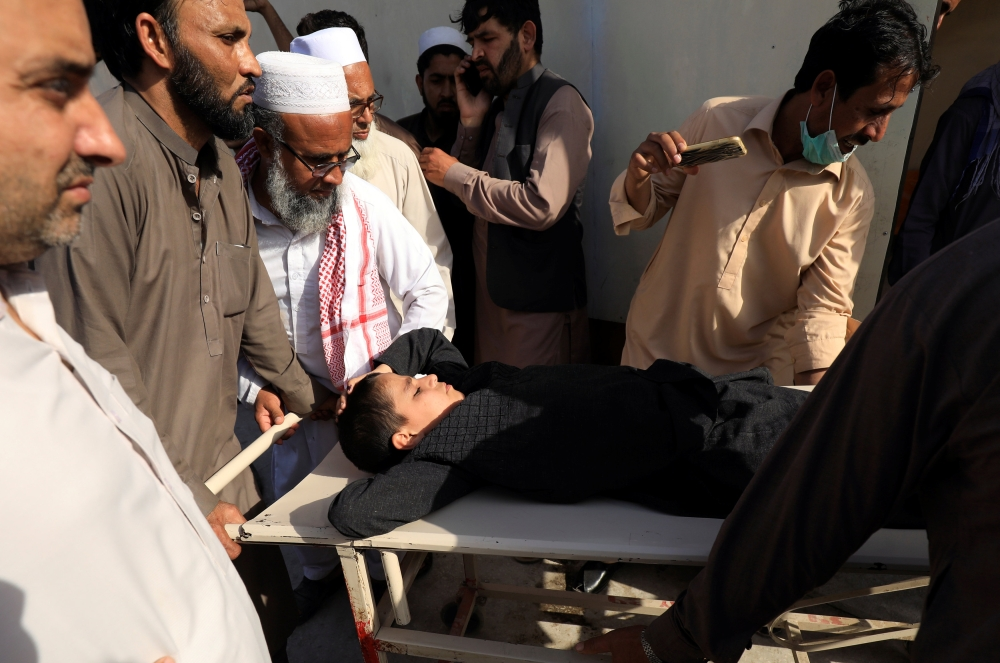 People move a child on stretcher after what they say was a defective vaccine administered outside a hospital in Peshawar, Pakistan, in this April 22, 2019 file photo. — Reuters