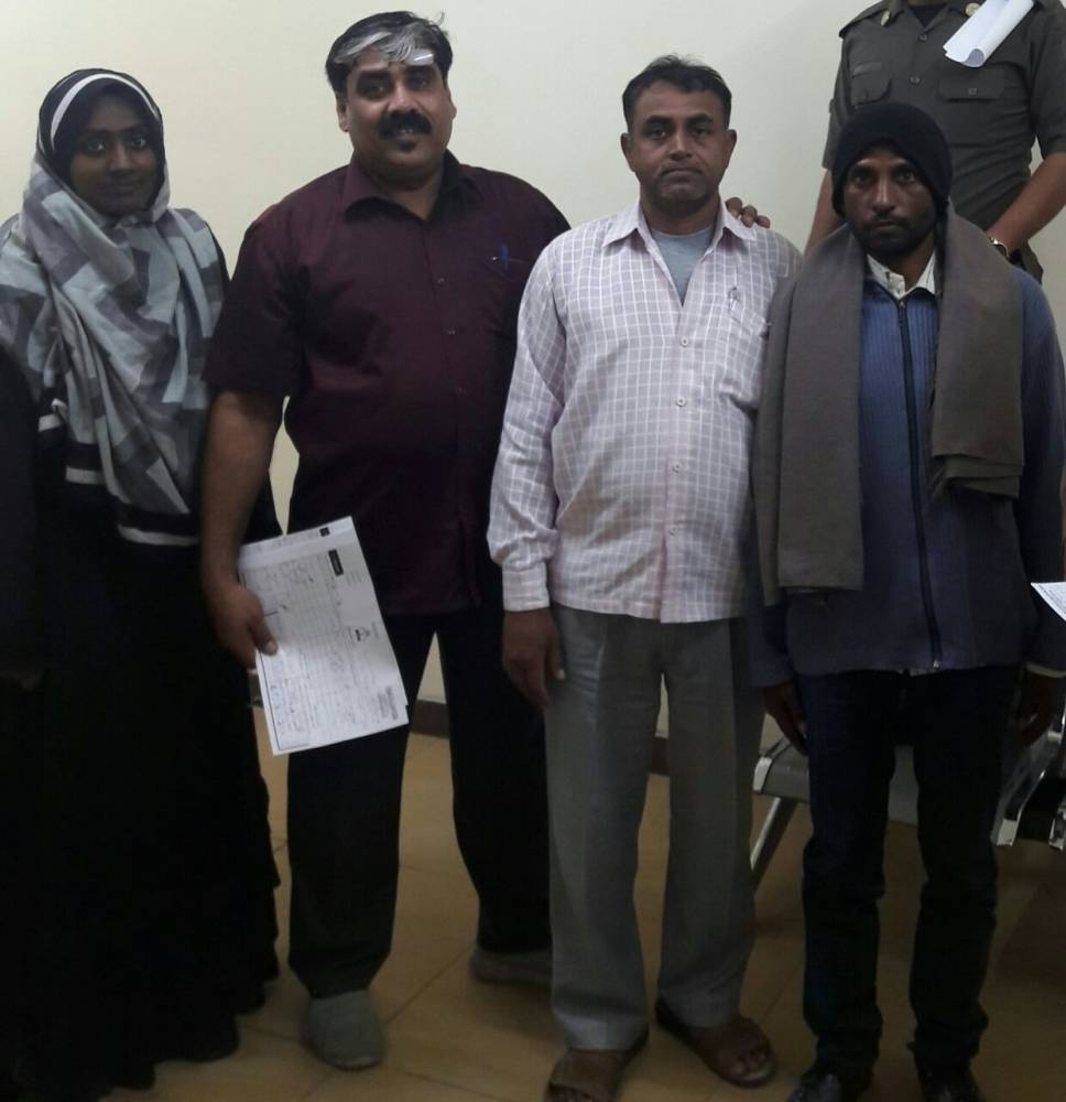 Shoukat Nass, second from left, with some of his compatriots who needed his assistance.