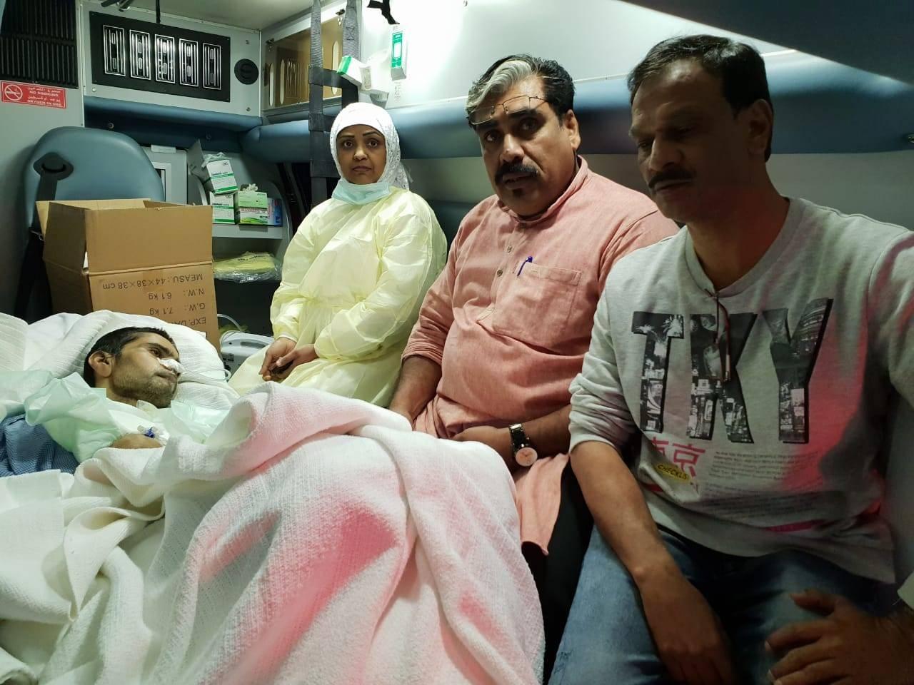 Shoukat Nass accompanies a comatose patient.