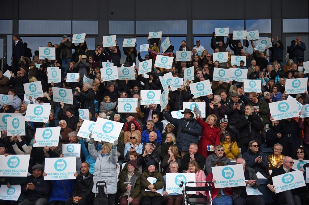 Brexit Party supporters hold up placards during a rally with the Brexit Party's north west candidates in Fylde, north west England on Sunday, in the build up to the European elections. — AFP