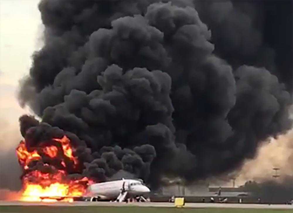This handout grab of a video obtained from the Instagram account of Gunkevitch on Sunday, shows a fire of a Russian-made Superjet-100 at Sheremetyevo airport outside Moscow. — AFP