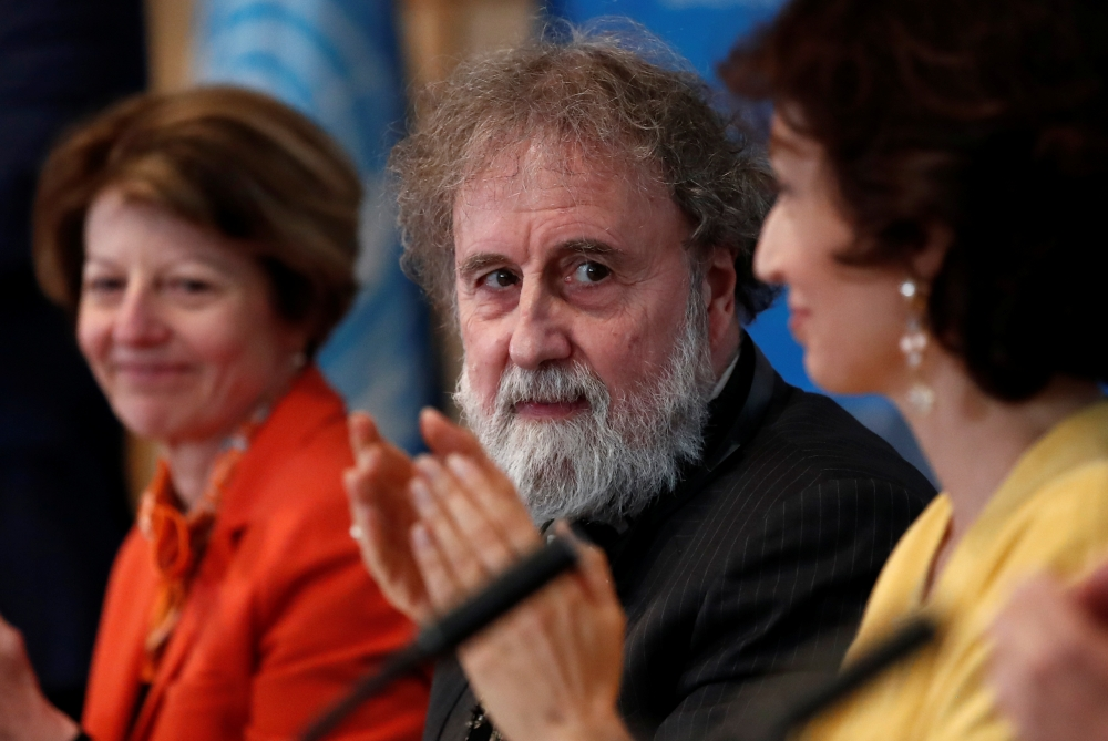 Former IPBES (Intergovernmental Science-Policy Platform on Biodiversity and Ecosystem Services) Chair Robert Watson is applauded as he attends a news conference on the launching of a landmark report on the damage done by modern civilization to the natural world by the IPBES at the UNESCO headquarters in Paris, France, on Monday. — Reuters