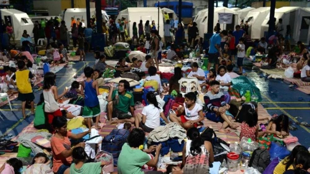 Residents take shelter at an evacuation center for people displaced by flash floods in Quezon City, Philippines. — Reuters